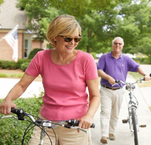 Senior couple enjoying a bike around around The Cypress of Raleigh